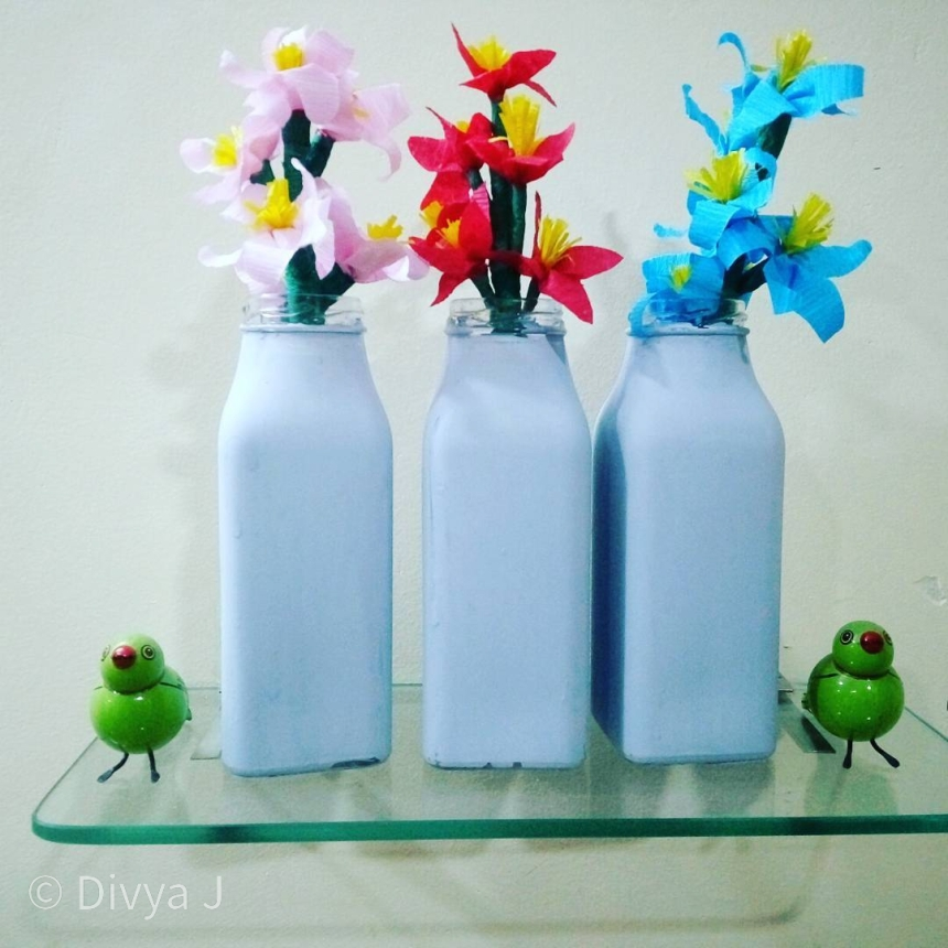 Hand painted Glass Bottle with Chalk paint along with crepe paper flower handmade
