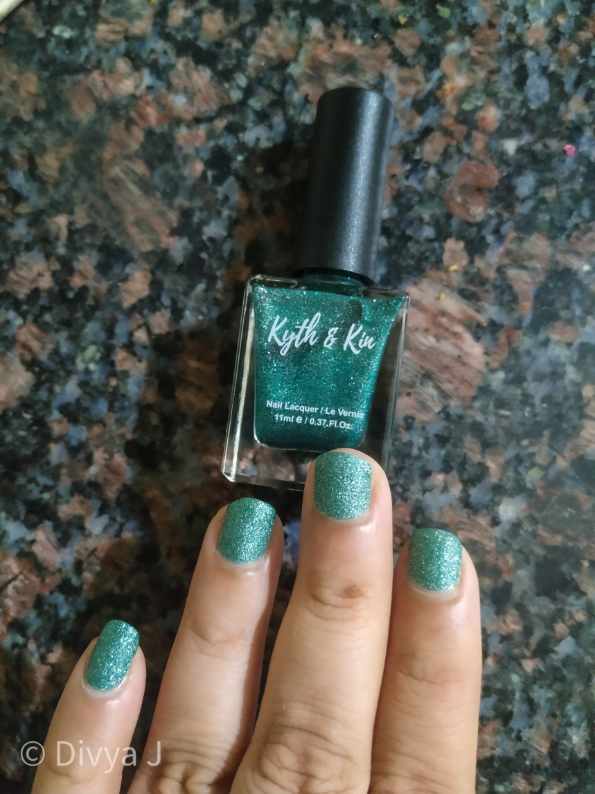 2 coats of Kyth & Kin Sugar Finish Nail Lacquer-Sugar Lust in Artificial Light night time