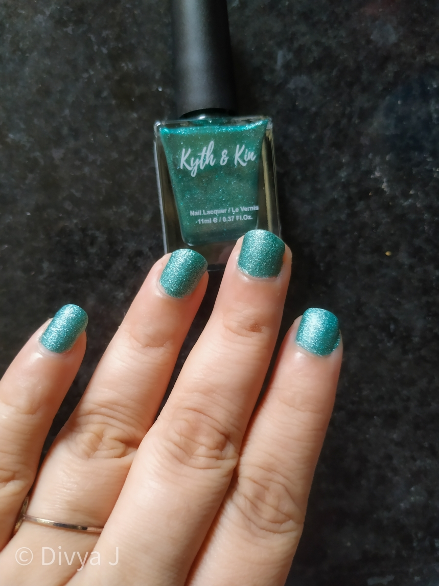 3 coats of Kyth and Kin Sugar Finish Nail Lacquer-Sugar Lust in natural day light inside house hand swatch