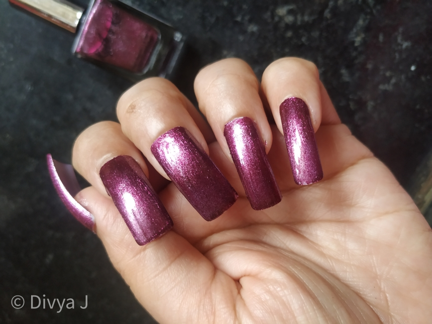 Fake nail Swatch of Kyth and kin metallic nail lacquer Purple Haze