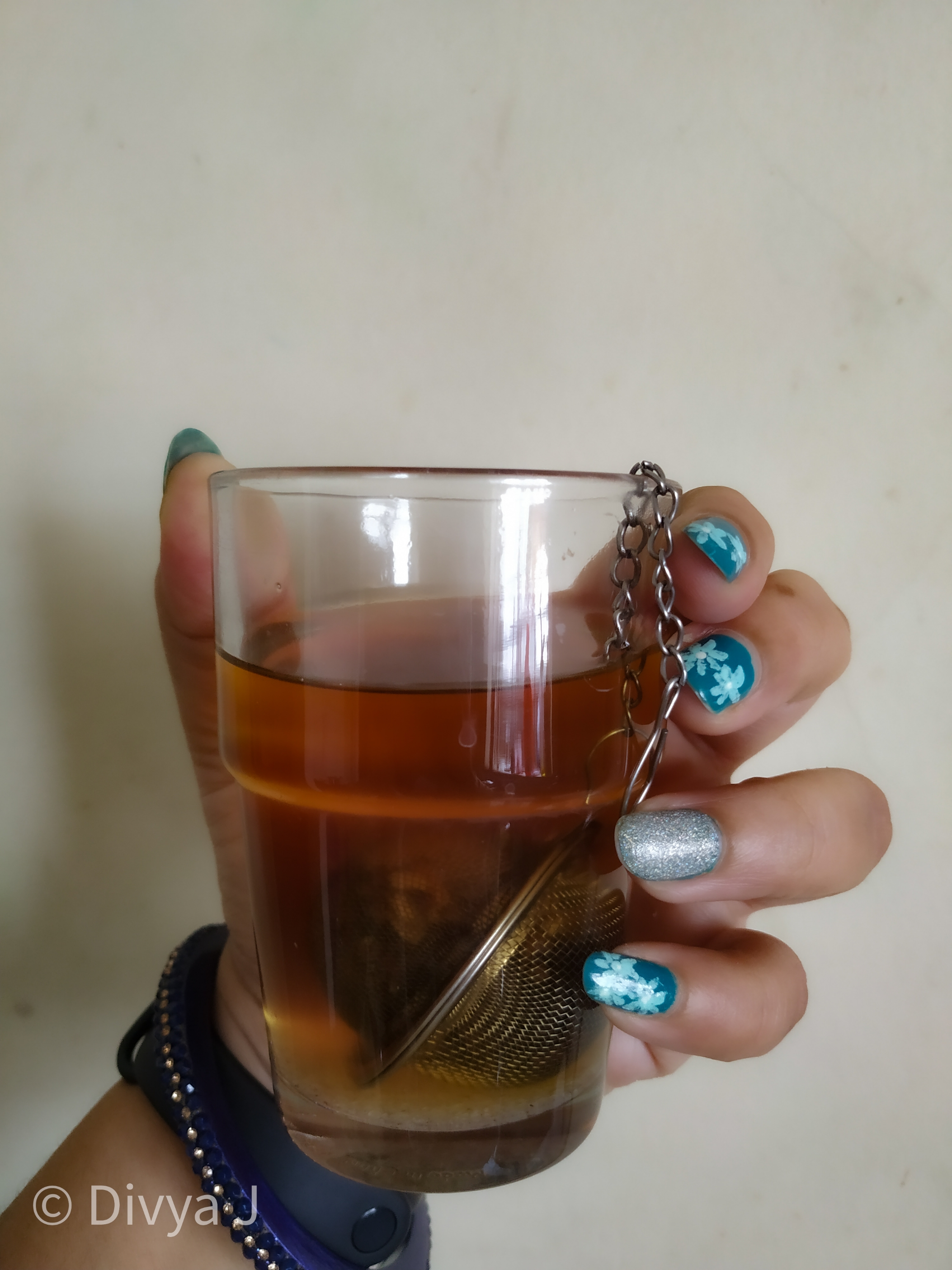 Glass shot with hand of Tea Trunk Apple spice black tea