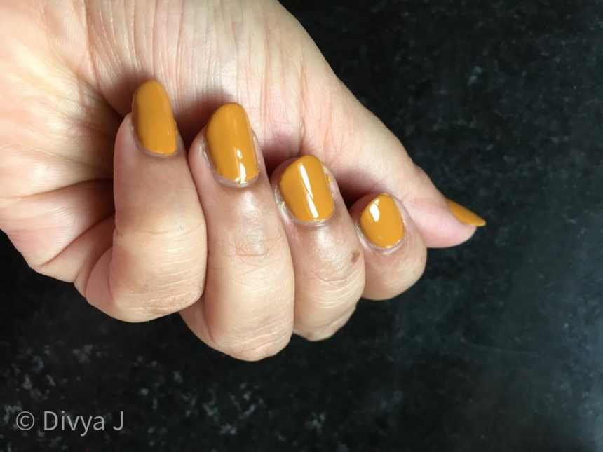 Hand swatch picture of H&M Golden Turmeric nail polish