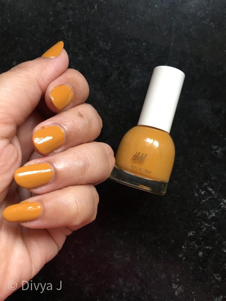 Nail and bottle shot of H &M Golden Turmeric nail polish