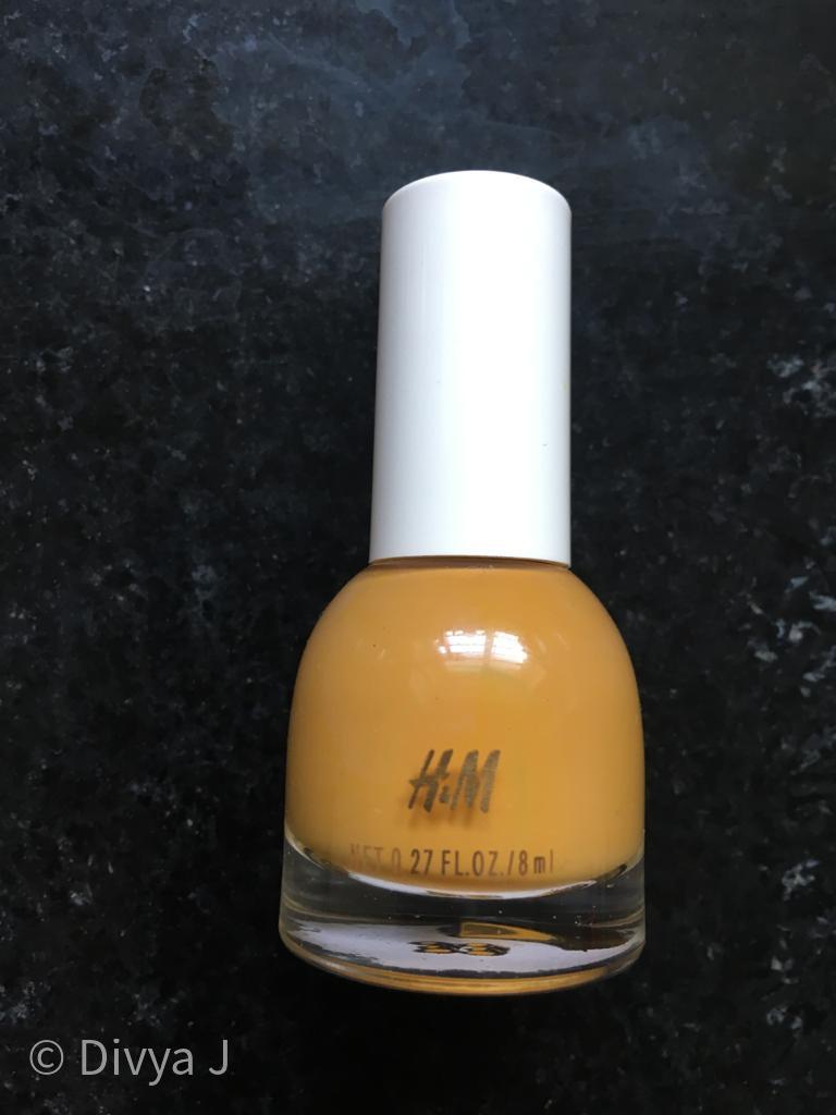 Bottle shot of H&M nail polish in Golden Turmeric shade
