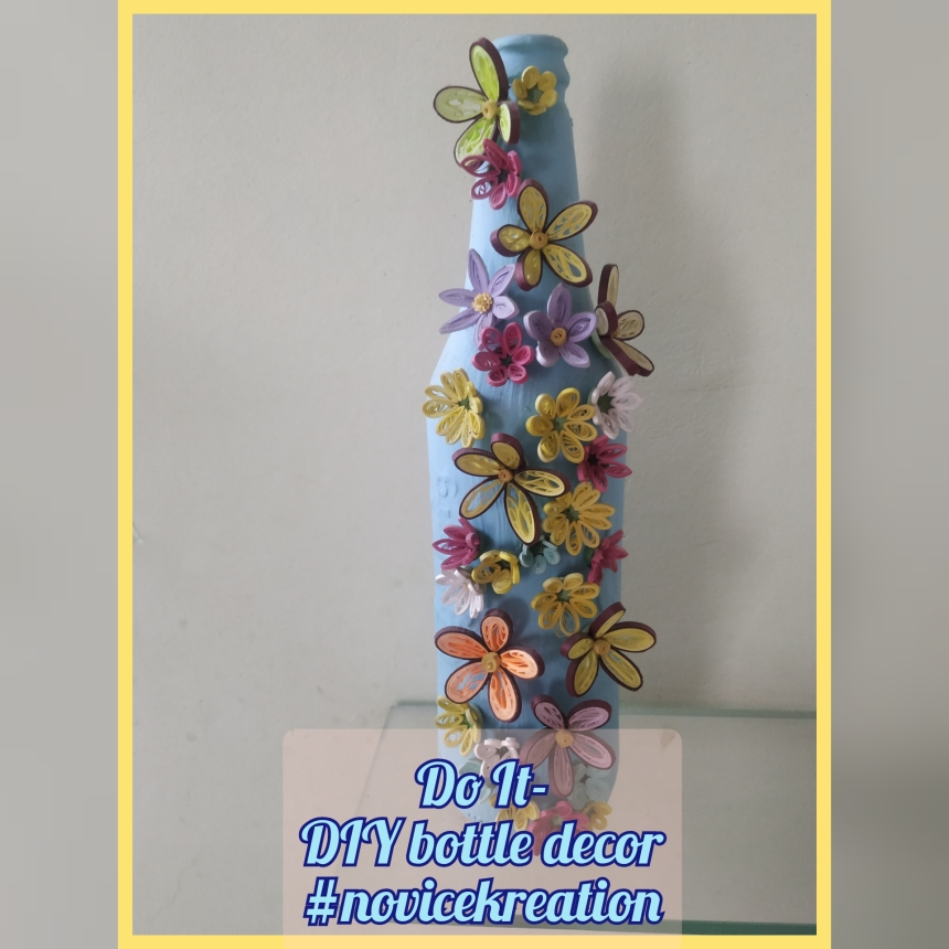 Glass bottle painting with quilled flowers