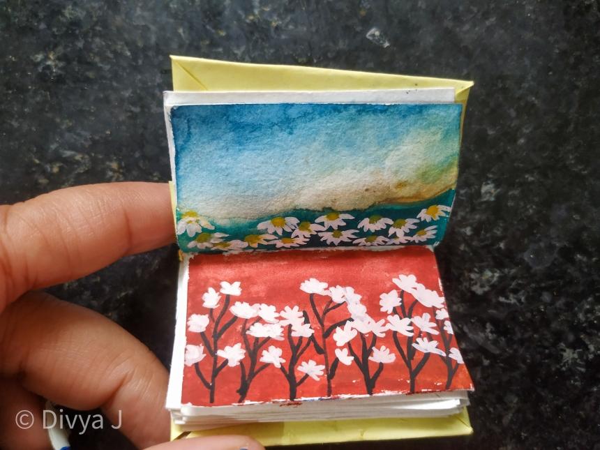 Flower and sky watercolor painting on DIY sketchbook
