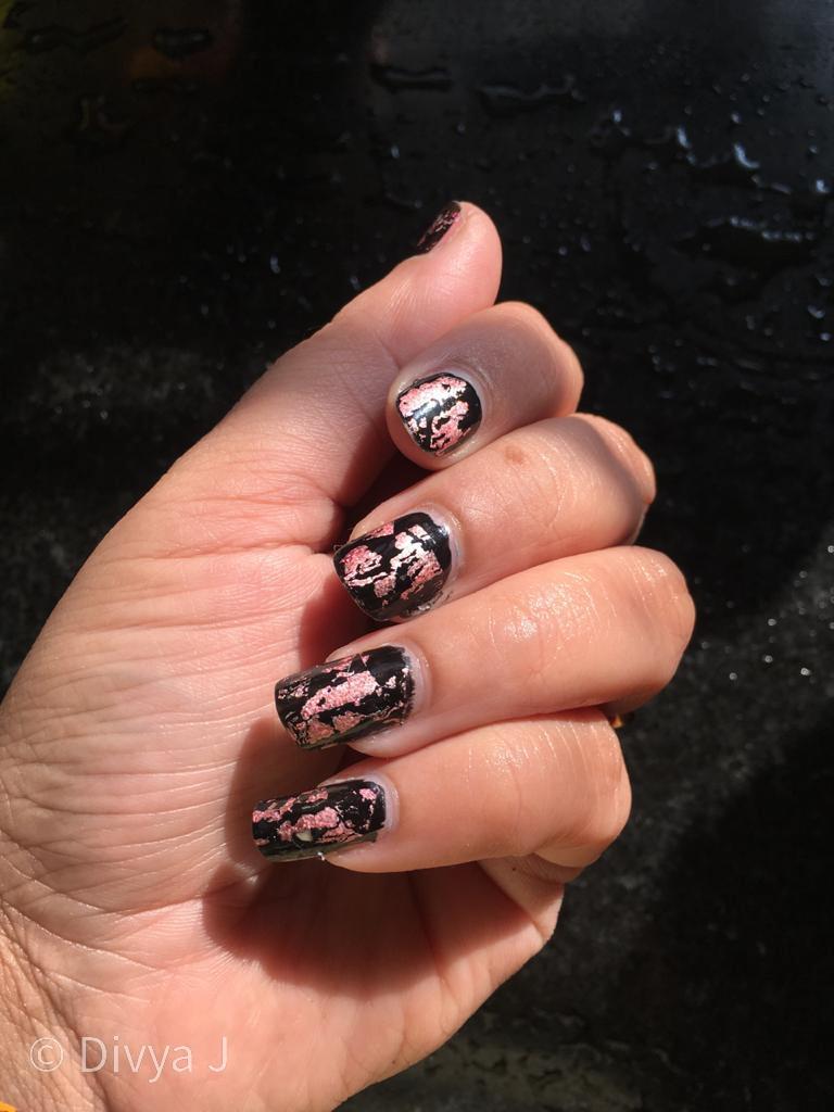 Pink nail foil on black nail polish